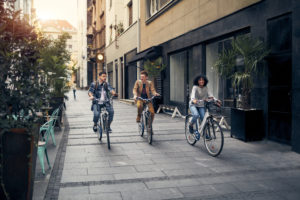Friends Riding Bicycles In A City